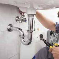 Plumber Mondeorworking on a faulty basin in Mondeor